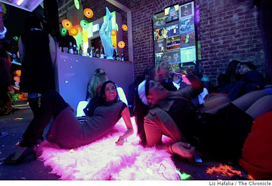 A blacklight room exhibit at the Andy Warhol Factory party.  Inspired by the DeYoung Museum's current Warhol Exhibit, the East Bay Express and Amoeba Music turned an East Bay warehouse into Andy Warhol's Factory for a party in Emeryville,  Calif., on Friday, March 6, 2009. Photo: Liz Hafalia, The Chronicle