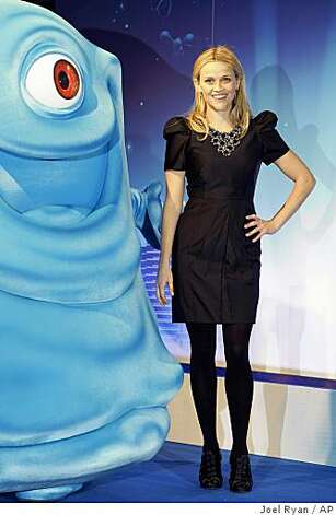 "U.S. actress Reese Witherspoon arrives for the British premiere of ""Monsters vs. Aliens,"" in Leicester Square, London, Wednesday, March 11, 2009. Photo: Joel Ryan, AP"