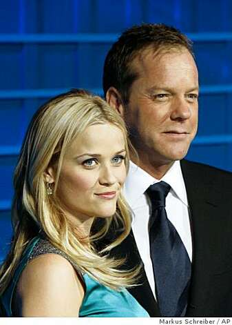 U.S. actress Reese Witherspoon, left, and U.S. actor Kiefer Sutherland, right, arrive at the premiere of the animation movie 'Monsters vs Aliens' in Berlin Monday March 9, 2009. Photo: Markus Schreiber, AP