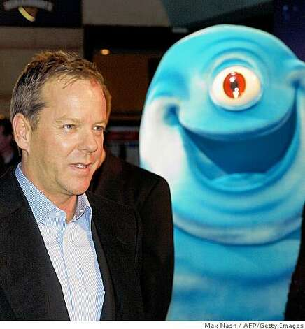 "Actor Kiefer Sutherland poses with BOB, one of the characters from the film ""Monsters versus Aliens,"" as he arrives for the British Premiere of his latest film in London's Leicester Square on March 11, 2009. Photo: Max Nash, AFP/Getty Images"