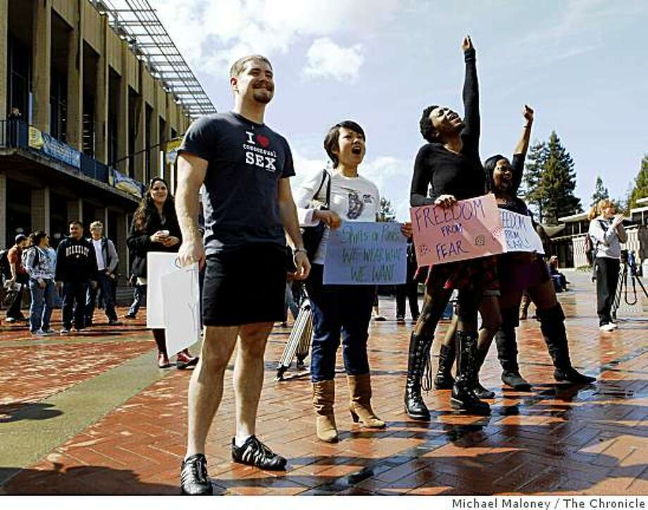 """From left, UC Berkeley students Colin Beck (wearing a dress), Laury Thammavong, Tracie Raymond and Joy Sargent  attended a """"Skirt Rally"""" held at Sproul Plaza on the Cal campus in Berkeley, Calif., on Wednesday, March 4, 2009. Organizers held the rally to  raise awareness about a sexual predator who has been assaulting women in Berkeley. Photo: Michael Maloney, The Chronicle"""