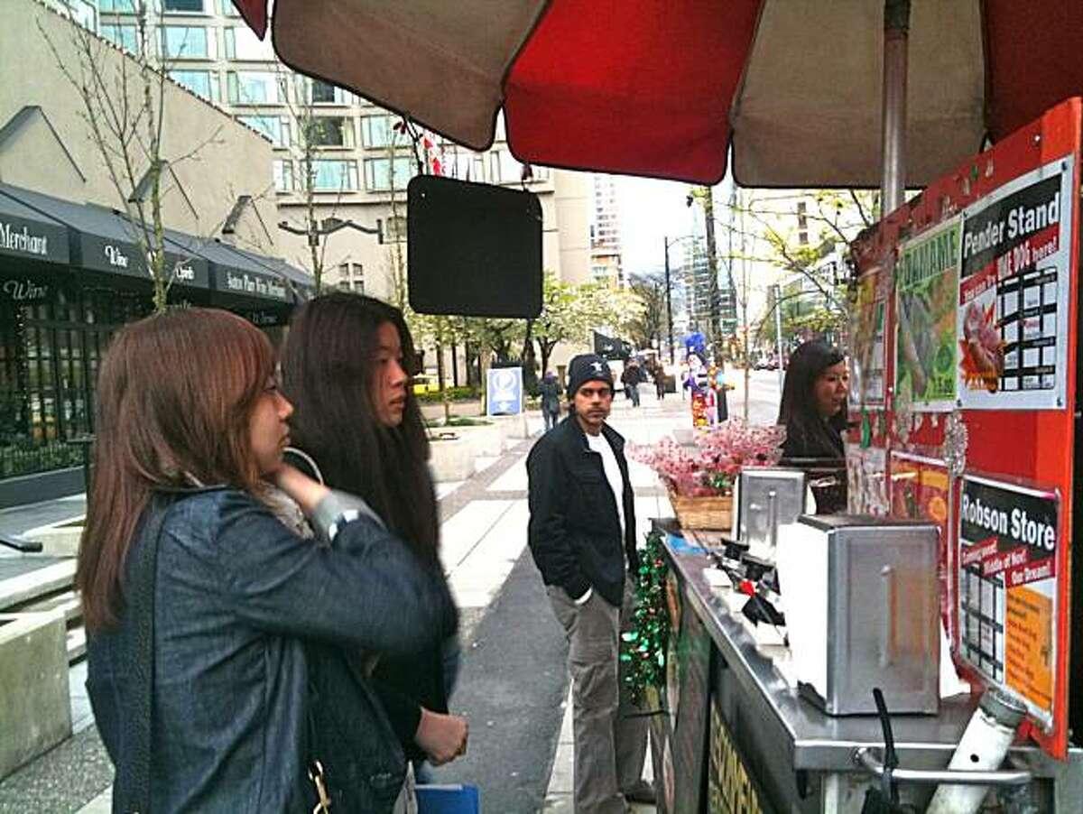 Customers wait on line at Vancouver's Japadog.