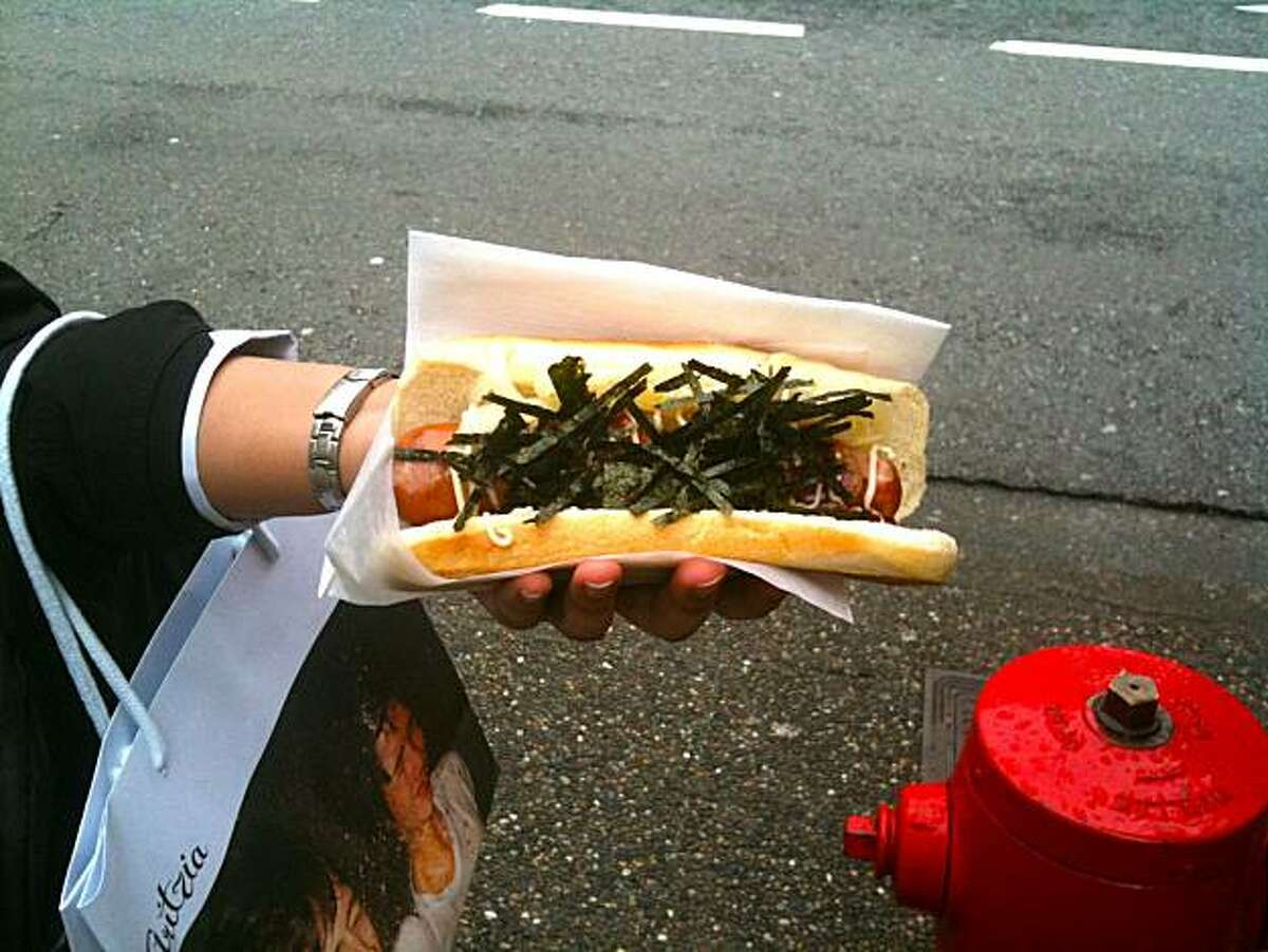 Hot off the grill at Japadog, the wildly popular hotdog stand in Vancouver.