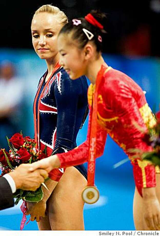 Nastia Liukin of Parker, Texas watches as He Kexin of China is awarded the gold medal for the uneven bars during gymnastics event finals at the 2008 Summer Olympic Games, Monday, Aug. 18, 2008, in Beijing. Liukin tied with He on the apparatus with identical scores of 16.725 but tiebreaking procedures placed her second. Photo: Smiley N. Pool, Chronicle