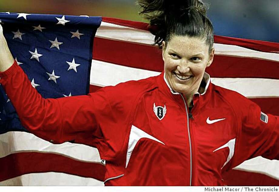 USA's Stephanie Brown Trafton, Olympic gold medalist in the women's discus throw, parades the U.S. flag around the stadium at the 2008 Olympics in Beijing, China, Monday Aug. 18, 2008. Photo: Michael Macor, The Chronicle