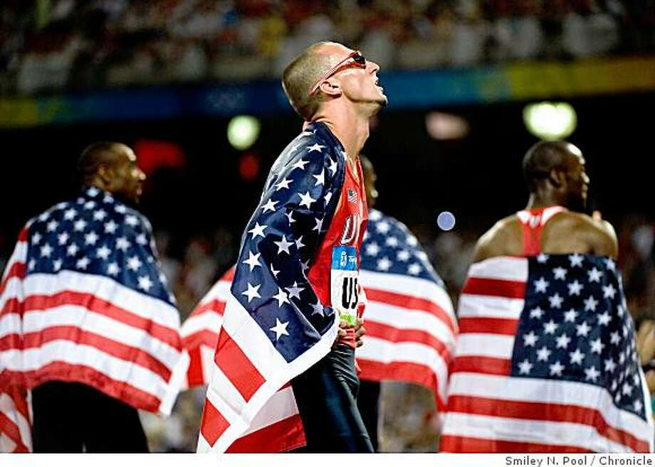 Jeremy Wariner of the USA watches a replay of the race after the men's 4x400 relay team won the gold medal in athletics (track and field) at the 2008 Summer Olympic Games, Saturday, Aug. 23, 2008, in Beijing.  ( Smiley N. Pool / Chronicle ) Photo: Smiley N. Pool, Chronicle