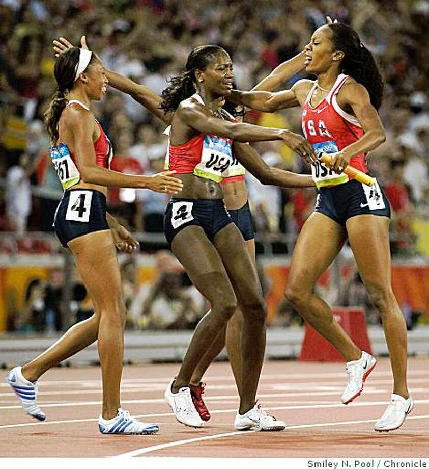 Sanya Richards of the USA, right, celebrates with teammates Mary Wineberg, center, and Allyson Felix, left after winning the women's 4x400 meter relay in athletics (track and field) at the 2008 Summer Olympic Games, Saturday, Aug. 23, 2008, in Beijing. Monique Henderson is behind Wineberg. ( Smiley N. Pool / Chronicle ) Photo: Smiley N. Pool, Chronicle