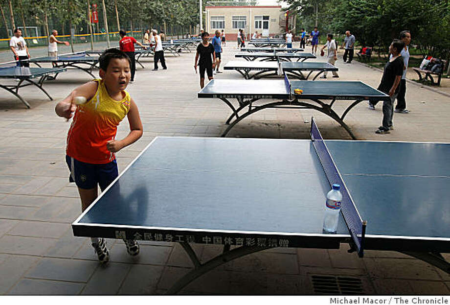 Young and old alike turn out for a little table tennis at Sun Park in North Eastern Beijing. Photo: Michael Macor, The Chronicle