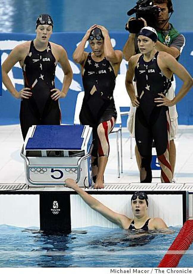 The 4x100 Freestyle finals with the USA  team of Allison Schmitt, Caroline Burckle, Natalie Coughlin and Katie Hoff, (water) react after their swim which finished them in third place for the Bronze medal. Photo: Michael Macor, The Chronicle