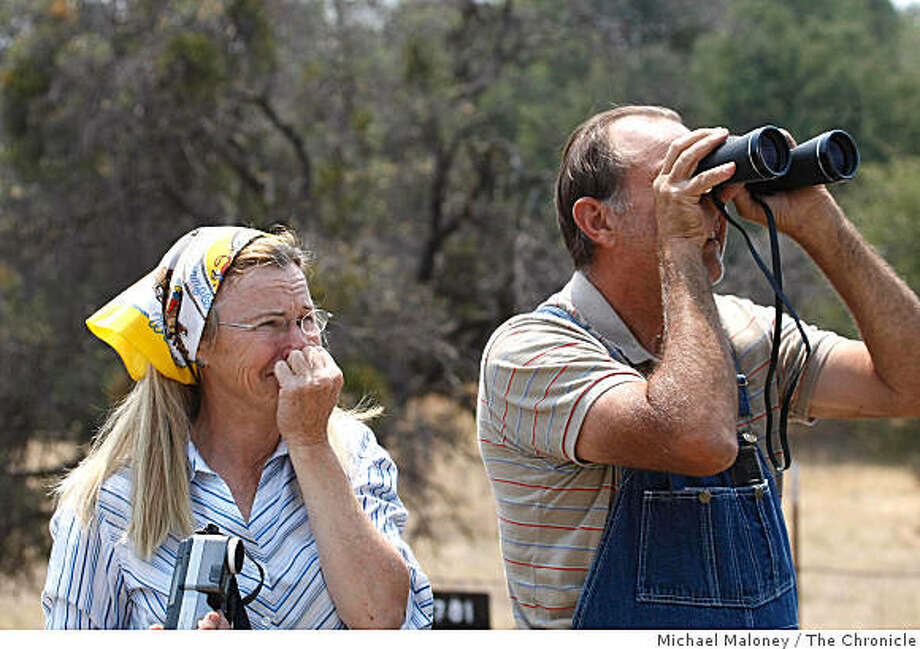 Jennifer Strawbridge and her husband Harry watch their property go up in flames on the slopes of Mt Bullion near Mariposa. The Strawbridge's are from Atwater and were building a retirement home on the site.Nearly 1,000 firefighters from throughout the state fought a fast growing wildfire that burned over 18,000 acres near Midpines, Calif., on July 27, 2008. Photo by Michael Maloney / The Chronicle Photo: Michael Maloney, The Chronicle
