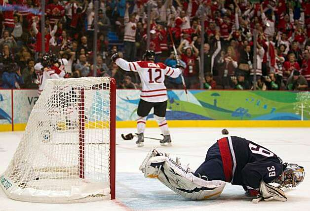 USA goalie Ryan Miller collapses to the ice as Canada players celebrate after Sidney Crosby celebrates after scoring the game-winner over the USA during the overtime period in the men's ice hockey gold medal game at the 2010 Winter Olympics on Sunday, FebUSA goalie Ryan Miller collapses to the ice as Canada players celebrate after Sidney Crosby celebrates after scoring the game-winner over the USA during the overtime period in the men's ice hockey gold medal game at the 2010 Winter Olympics on Sunday, Feb. 28, 2010, in Vancouver. Canada won the game 3-2 on a goal by Canada's Sidney Crosby. Photo: Smiley N. Pool, Chronicle Olympic Bureau