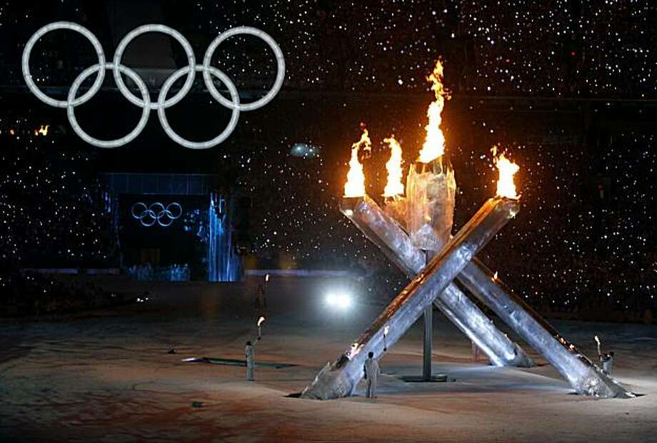 During the Opening Ceremonies of the Winter Games at BC Place in Vancouver, one of the pillars (at left) designed to hold the flames fails to be lifted out of the ground as torch bearers, including hockey great Wayne Gretzky and basketball player Steve NTorch bearers, including hockey great Wayne Gretzky and basketball player Steve Nash, light thehugr Olympic cauldron to signify the start of the Winter Olympic Games at BC Place stadium in Vancouver, B.C., on Friday, Feb. 12, 2010. Photo: Paul Chinn, The Chronicle
