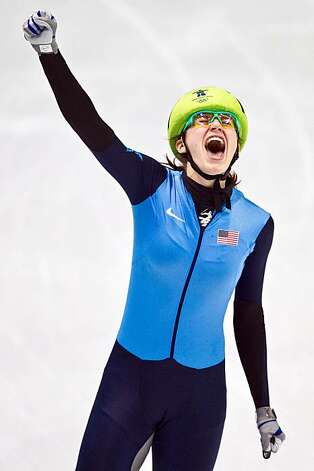 Katherine Reutter of the USA celebrates after winning the silver medal in the women's 1000 meters in short track speedskating at the 2010 Winter Olympics on Friday, Feb. 26, 2010, in Vancouver.  ( Smiley N. Pool / Houston Chronicle) Photo: Smiley N. Pool, Chronicle Olympic Bureau