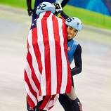 Apolo Anton Ohno of the USA	celebrates by lifting upt eammate J.R. Celski after Ohno captured his sixth olympic medal after finishing second with a time of  2:17.976 to capture the silver during the mens' 15000 meter finals in short track speed skating atApolo Anton Ohno of the USA	celebrates by lifting upt eammate J.R. Celski after Ohno captured his sixth olympic medal after finishing second with a time of  2:17.976 to capture the silver during the mens' 15000 meter finals in short track speed skating at 2010 Winter Olympic Games at the Pacific Coliseum on Saturday, Feb. 13, 2010, in Vancouver.
