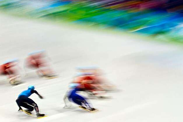 USA's Travis Jayner, bottom left, spins skates through a turn during the men's 5000 meter relay in short track speedskating at the 2010 Winter Olympics on Friday, Feb. 26, 2010, in Vancouver.  Canada took the gold.  Korea took the silver.  The USA won broUSA's Travis Jayner, bottom left, spins skates through a turn during the men's 5000 meter relay in short track speedskating at the 2010 Winter Olympics on Friday, Feb. 26, 2010, in Vancouver.  Canada took the gold.  Korea took the silver.  The USA won bronze, giving USA's Apolo Anton Ohno his record eighth Olympic medal. Photo: Smiley N. Pool, Chronicle Olympic Bureau