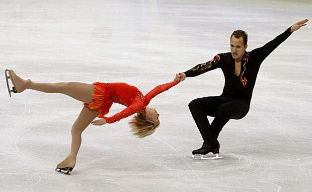 Caydee Denney and Jeremy Barrett of the United States perform their short program in the pairs skating competition at the Winter Olympic Games in Vancouver, B.C., on Sunday.Caydee Denney (left) and Jeremy Barrett of the United States perform their short program in the pairs skating competition at the Winter Olympic Games in Vancouver, B.C., on Saturday, Feb. 13, 2010. Denney and Barrett finished in 14th place after the sh.ort program. Photo: Paul Chinn, The Chronicle
