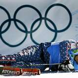 Daron Rahlves of the United States collapses at the finish line after being eliminated from the men's ski cross competition at the Winter Olympic Games in West Vancouver, British Columbia, on Sunday.