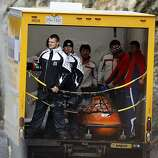 Bobsleigh teams take unglamorous transportation back up the hill for another run. USA 1 won the gold medal in the four-man bobsleigh competition at the Winter Olympic Games in Whistler, British Columbia, on Saturday.