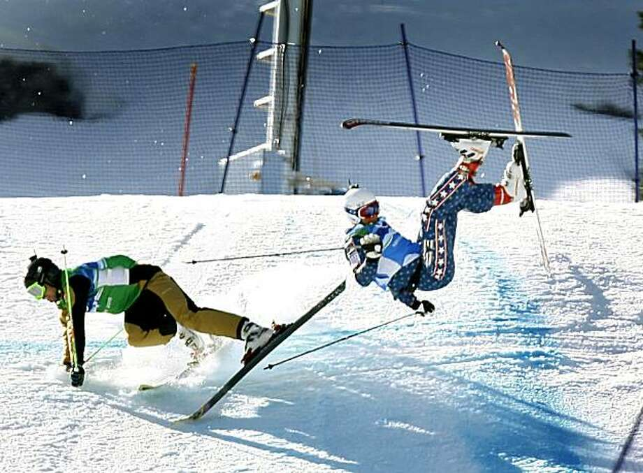 Ted Piccard, left, of France and Daron Rahlves of the United States lose control near the bottom of the run in the men's ski cross competition at the Winter Olympic Games in West Vancouver, British Columbia, on Sunday. Rahlves was eliminated from the event after finishing in third place. Photo: Paul Chinn, The Chronicle