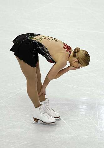 Joannie Rochette of Canada breaks down after her short program of the women's figure skating competition in Vancouver, British Columbia, on Tuesday. Rochette's mother died of a heart attack Sunday, one day after arriving in town to watch Rochette competeJoannie Rochette of Canada breaks down after her short program of the women's figure skating competition in Vancouver, British Columbia, on Tuesday, Feb. 23, 2010. Rochette's mother died of a heart attack on Sunday one day after arriving in town to watch Joannie compete in the Olympics. Photo: Paul Chinn, The Chronicle