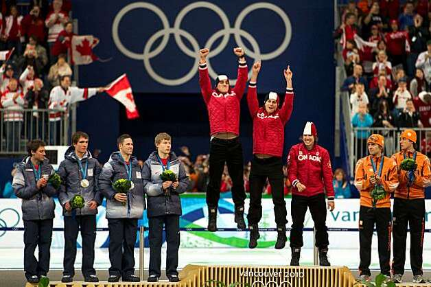USA speed skaters, from left, Trevor Marsicano, Jonathan Kuck, Chad Hedrick and Brian Hansen watch as the team from Canada celebrates on the awards stand after the USA captured the silver medal in the men's team pursuit speed skating at the 2010 Winter OlUSA speed skaters, from left, Trevor Marsicano, Jonathan Kuck, Chad Hedrick and Brian Hansen watch as the team from Canada celebrates on the awards stand after the USA captured the silver medal in the men's team pursuit speed skating at the 2010 Winter Olympics on Saturday, Feb. 27, 2010, in Vancouver. Canada won the gold. Photo: Smiley N. Pool, Chronicle Olympic Bureau