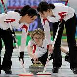 VANCOUVER, BC - FEBRUARY 26:  Janine Greiner (C) of Switzerland releases the stone as Carmen Schaefer (L) and Carmen Kueng brush the ice during the women's bronze medal curling game between China and Switzerland on day 15 of the Vancouver 2010 Winter Olympics at the Vancouver Olympic Centre on February 26, 2010 in Vancouver, Canada.