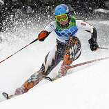 Finland's Tanja Poutiainen speeds down the course during the first run of the Women's slalom, at the Vancouver 2010 Olympics in Whistler, British Columbia, Friday, Feb. 26, 2010.