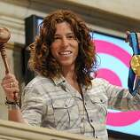 US Olympic snowboard gold medalist Shaun White holds the gavel and his gold medal aloft just before he rings the closing bell February 23, 2010 at the New York Stock Exchange to celebrate his recent victory at the Vancouver Winter Olympics.