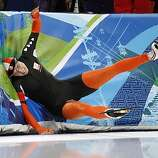 Netherlands's Annette Gerritsen crashes during the first of two heats of the women's 500 meter race at the Richmond Olympic Oval at the Vancouver 2010 Olympics in Vancouver, British Columbia, Tuesday, Feb. 16, 2010.