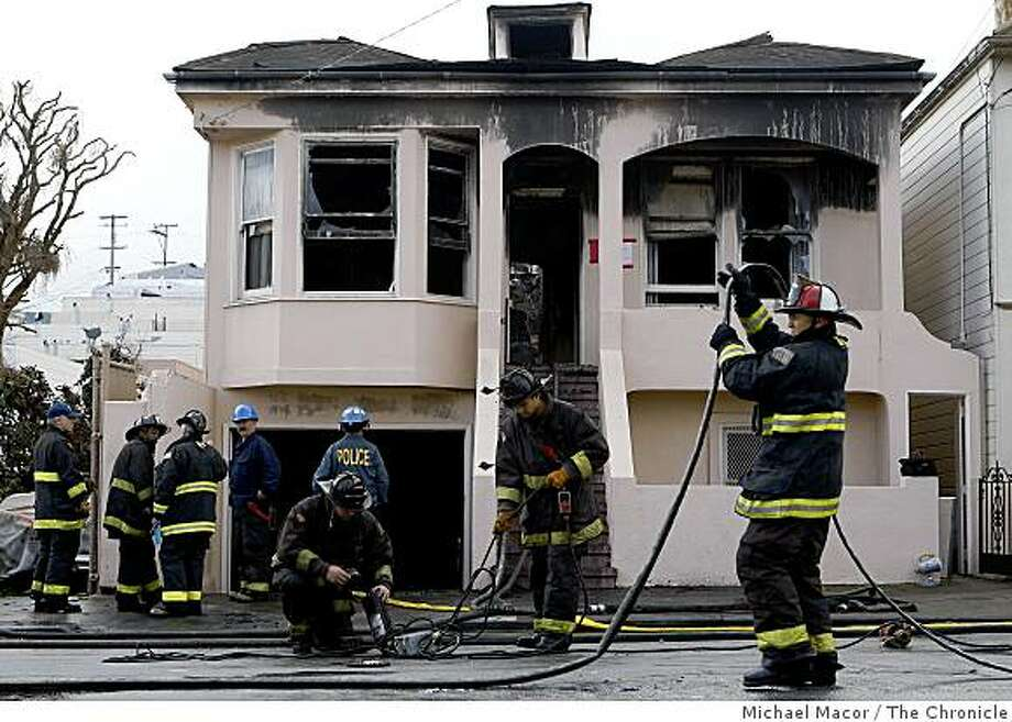 Firefighters clean up the scene of an early morning fire at 627 Felton St. in San Francisco. The fire left one firefighter with life-threatening injures. Photo: Michael Macor, The Chronicle