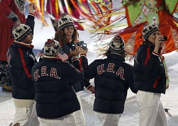 Snow boarder Shaun White, center, walks into BC Place stadium with teammates at the opening ceremony for the Winter Olympic Games in Vancouver, B.C., on Friday.Snow boarder Shaun White (center) walks into BC Place stadium with teammates at the opening ceremony for the Winter Olympic Games in Vancouver, B.C., on Friday, Feb. 12, 2010. Photo: Paul Chinn, The Chronicle