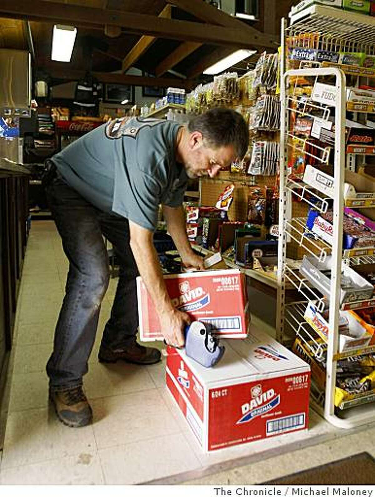 Kurt Mayer, co-owner of the Big Sur Center deli and store in Big Sur, Calif., replenishes his stock of sunflower seeds which he found was popular with the firefighters. Nearly 2,000 firefighters try to beat back the out-of-control Basin Complex wildfire near the coastal tourist town of Big Sur on July 6, 2008.Photo by Michael Maloney / The Chronicle
