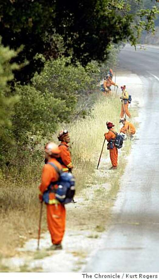 Fire crews line both sides of HWY 1 in Big Sur fan out in order to make sure the fire doesn�t jump to the west side of HWY 1. The fire is expected to heat up in the afternoon. on Saturday, July 05  2008 in Big Sur , Calif  Photo by Kurt Rogers / The Chronicle. Photo: Kurt Rogers, The Chronicle