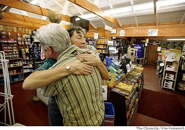 Suzy Tennyson embraces Drew Carlson at the River Inn General Store in the final hour of evacuations as residents and merchants evacuate the buildings near the Big Sur River Inn in the Big Sur fire area on Wednesday July 2, 2008 Photo by Kim Komenich / The Chronicle Photo: Kim Komenich, The Chronicle