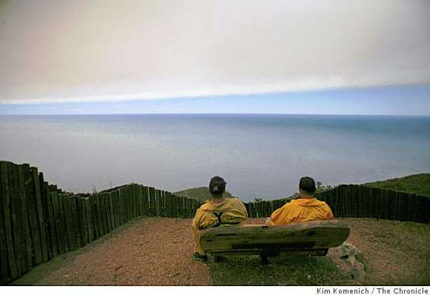 Firefighters Bob Frascona, left, and Glen Ewart of the Los Angeles County Fire Department look at the Pacific Ocean during a lunch break during their fire watch at Post Ranch Inn as the Basin Complex fire continues to burn in and around Big Sur, Calif., on Thursday, July 3, 2008 Photo: Kim Komenich, The Chronicle