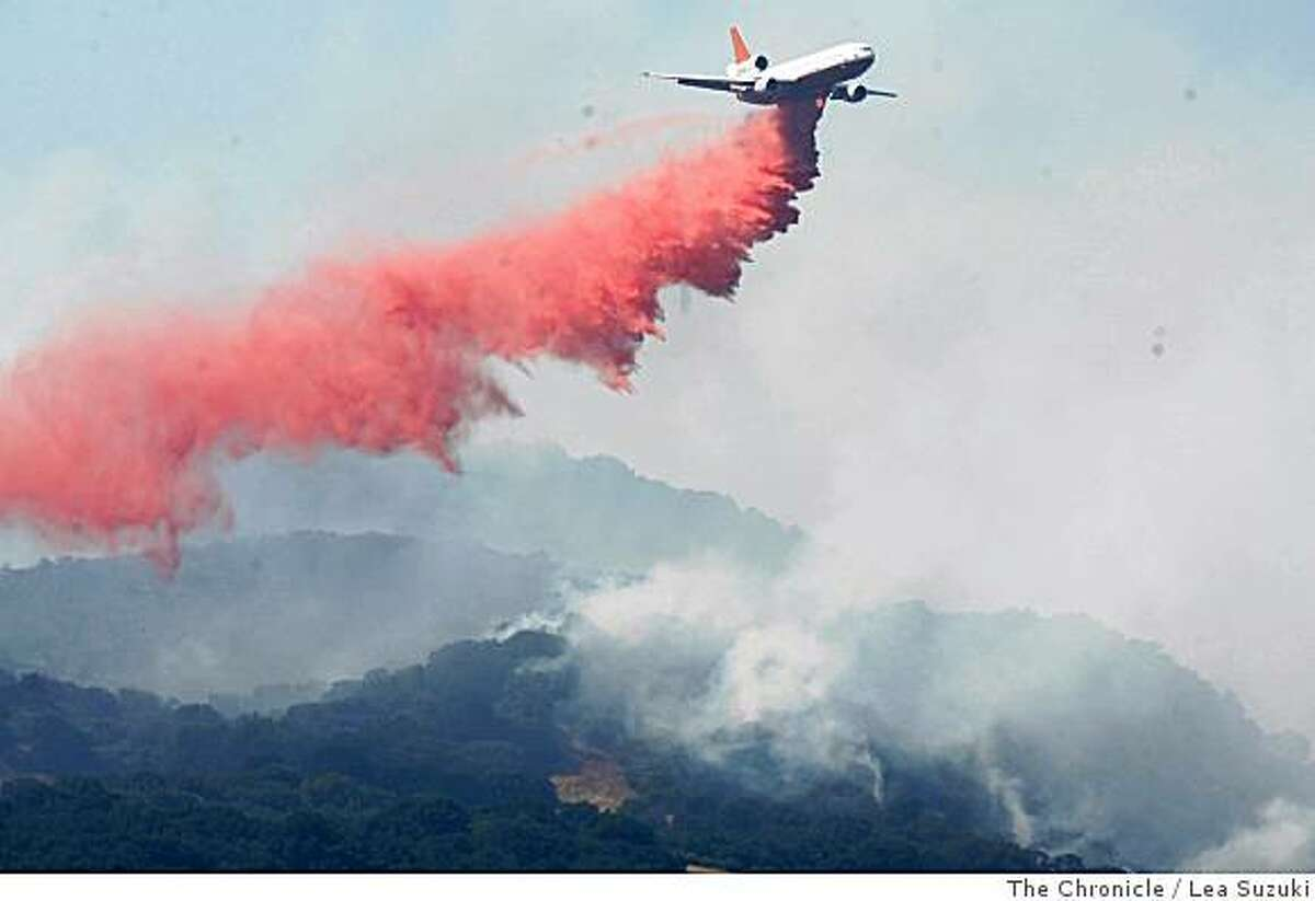 A DC-10 drops fire retardant on the fire in Green Valley, Calif. on Sunday June 22, 2008. Photo By Lea Suzuki/ The Chronicle