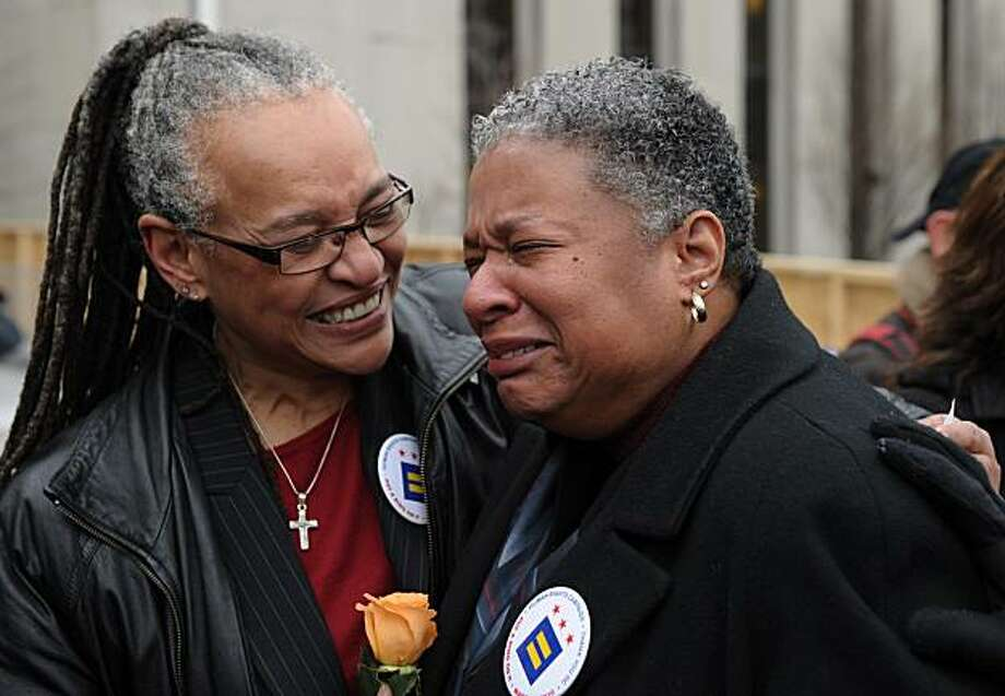 Darlene Garner (L) comforts her partner Candy Holmes after applying for their marriage license at the DC Superior Court March 3, 2010 in Washington, DC. Garner and Holmes have been together for 14 years. The US Supreme Court refused March 2 to block a lawallowing same-sex marriages in Washington DC, clearing the way for the legislation to go into effect Wednesday. Photo: Mandel Ngan, AFP / Getty Images