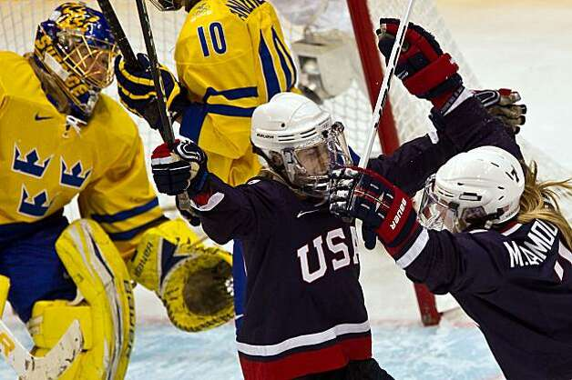USA's Jenny Potter celebrates with Monique Lamoureux (7) after Lamoureux scored against Sweden goalie Kim Martin in women's hockey semifinal action at the 2010 Winter Olympics on Monday, Feb. 22, 2010, in Vancouver. ( Smiley N. Pool / Houston Chronicle)USA's Jenny Potter celebrates with Monique Lamoureux (7) after Lamoureux scored against Sweden goalie Kim Martin in women's hockey semifinal action at the 2010 Winter Olympics on Monday, Feb. 22, 2010, in Vancouver. Photo: Smiley N. Pool, Chronicle Olympic Bureau