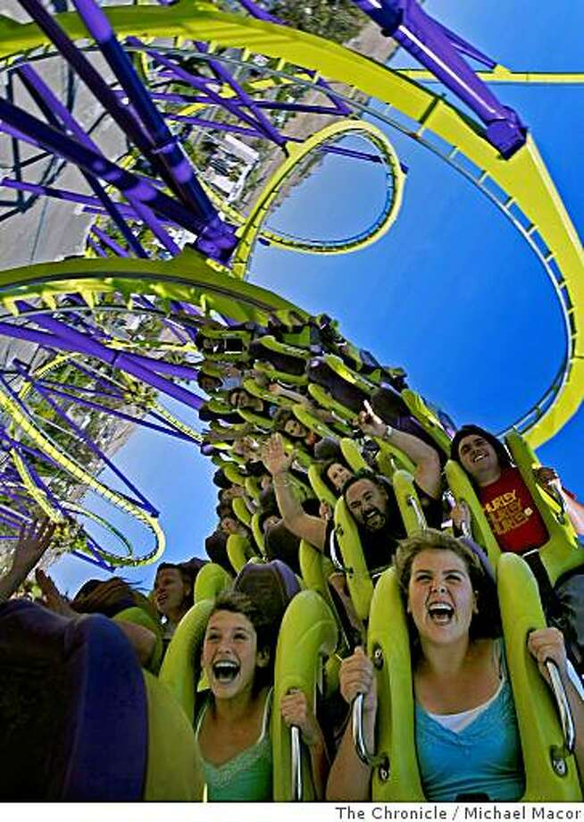 "Screams from riders as they are twisted through the turns of the  thrill ride, ""Medusa"", at Six Flags Discovery Kingdom in Vallejo, Calif., on June 5, 2008.Photo By Michael Macor/ The Chronicle Photo: Michael Macor, The Chronicle"