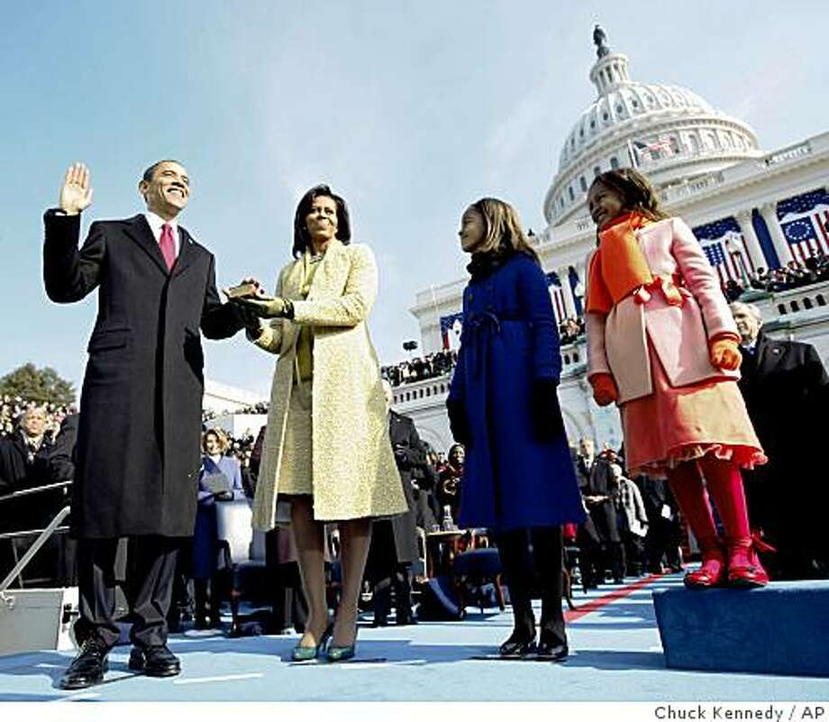 Barack Obama, left, takes the oath of office from Chief Justice John Roberts, not seen, as his wife Michelle, holds the Lincoln Bible and daughters Sasha, right and Malia, watch at the U.S. Capitol in Washington, Tuesday, Jan. 20, 2009. (AP Photo/Chuck Kennedy, Pool) Photo: Chuck Kennedy, AP