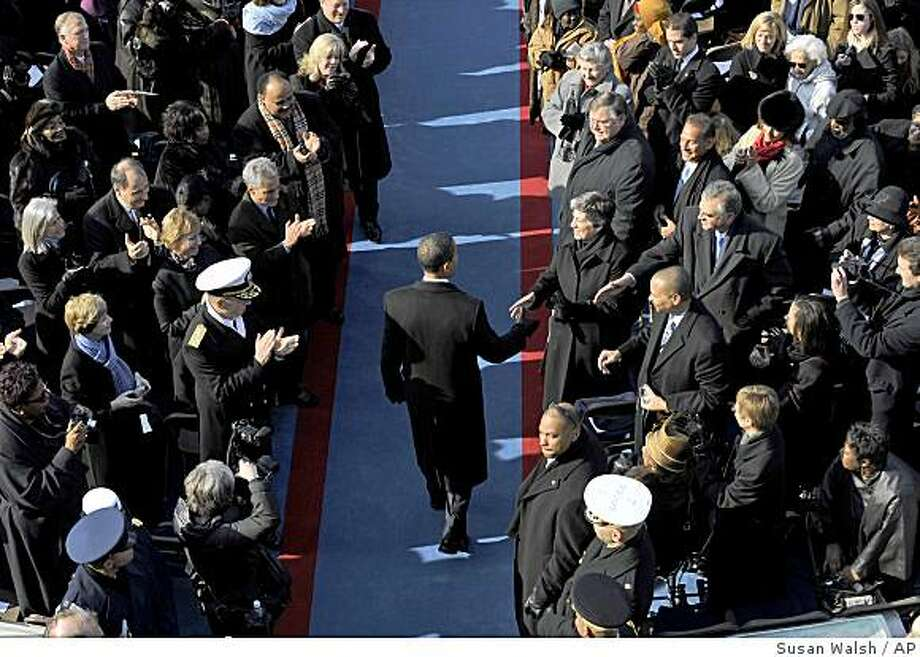 Barack Obama arrives for his inauguration at the U.S. Capitol in Washington, Tuesday, Jan. 20, 2009.  (AP Photo/Susan Walsh) Photo: Susan Walsh, AP