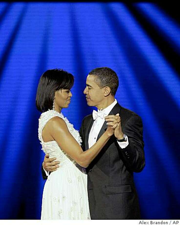 President Barack Obama and first lady Michelle Obama dance at the Neighborhood Inaugural Ball in Washington. Photo: Alex Brandon, AP