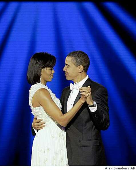 President Barack Obama and first lady Michelle Obama dance at the Neighborhood Inaugural Ball in Was