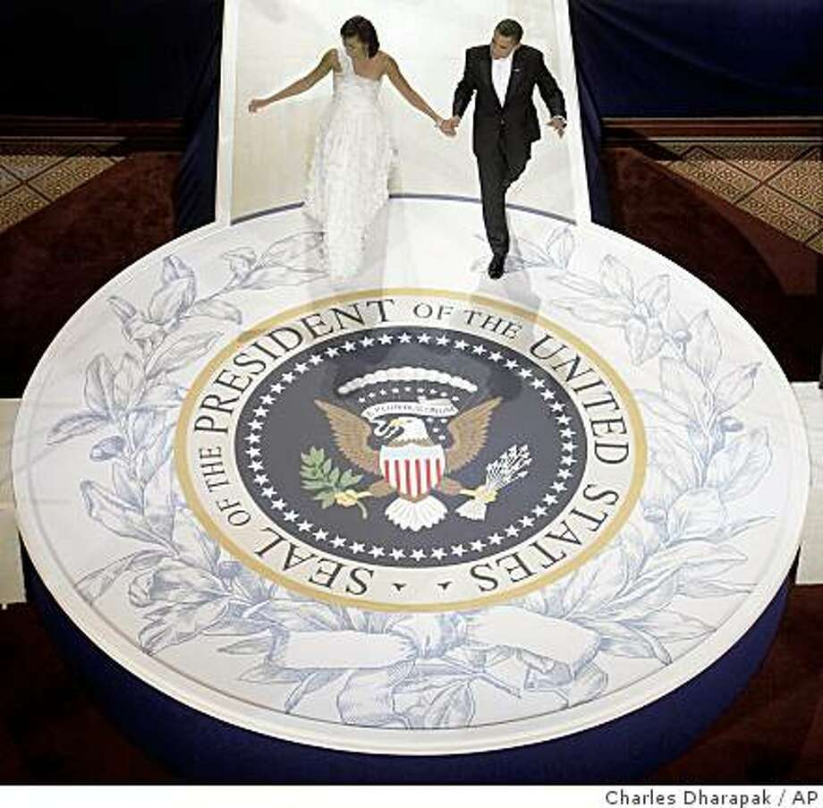 President Barack Obama and first lady Michelle Obama dance at the Commander in Chief Inaugural Ball at the National Building Museum in Washington, Tuesday, Jan. 20, 2009. Photo: Charles Dharapak, AP