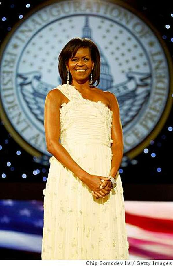 First Lady Michelle Obama attends the Neighborhood Inaugural Ball at the Washington Convention Center on January 20, 2009 in Washington, DC. Obama became the first African-American to be elected to the office of President in the history of the United States. Photo: Chip Somodevilla, Getty Images