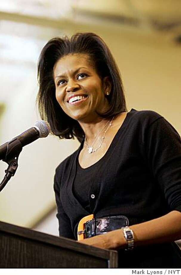 (NYT58) AKRON, Ohio -- Oct. 27, 2008 -- CAMPAIGN-MICHELLE-OBAMA-2 -- Michelle Obama, wife of Democratic presidential nominee Sen. Barack Obama, campaigns in Akron, Ohio, on Friday, Oct. 24, 2008. While some of the candidate's advisers once viewed Michelle Obama as an unpredictable spouse who sometimes spoke her mind a little too much, she is now widely regarded within the campaign as a disciplined and effective advocate who makes her husband�s case better than anyone else. (Mark Lyons/The New York Times) Photo: Mark Lyons, NYT