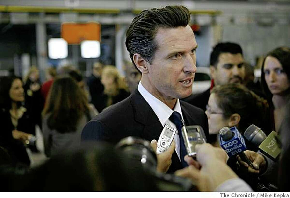 In front of a crowd of city employees and press, San Francisco Mayor, Gavin Newsom addresses his new budget plan in the San Francisco Police Department Tactical Operations center located in Hunters Point Shipyard on Monday, June 1, 2008, in San Francisco,Calif.
