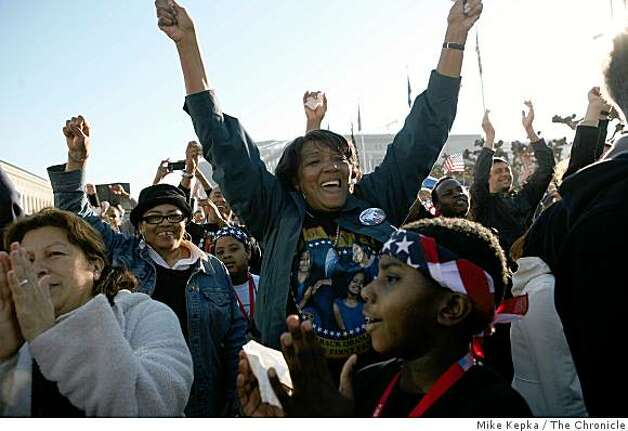 After Barack Obama was officially sworn in as President, Shirley Byles of San Francisco, Calif, throws her hands in the air as she joins thousands of others watching the inauguration of President Barack Obama on a giant TV screen in Civic Center Plaza on Tuesday January 20, 2009 in San Francisco, Calif. Photo: Mike Kepka, The Chronicle
