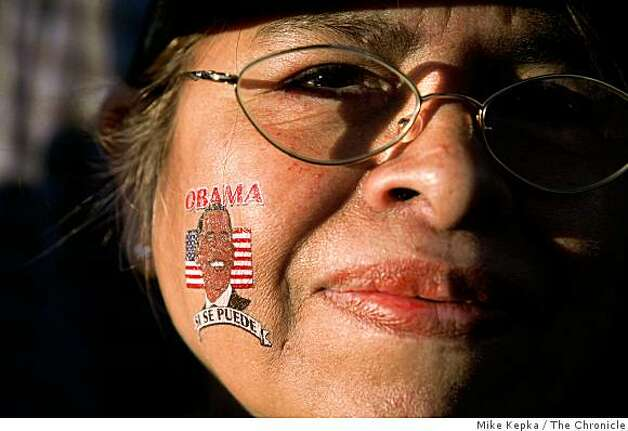 Rosa Juarez, of Springfield, Ill., proudly wears an Obama on her face as she joins thousands of others watching the inauguration of President Barack Obama on a giant TV screen in Civic Center Plaza in SF. Juarez, originally from Peru, recently became a U.S. citizen and her first vote was cast for Obama. Photo: Mike Kepka, The Chronicle