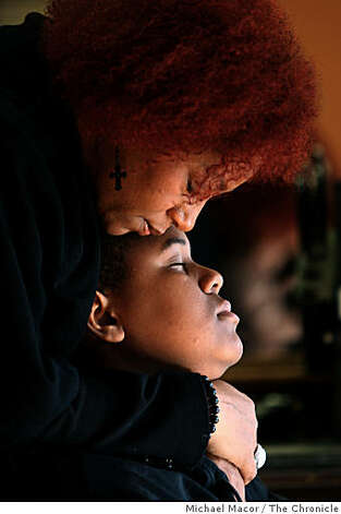 Felicia Williams of Tracy, Ca. hugs her son 14-year-old Soloman Burrell, during President Obama's acceptance speech,  joining family and friends at the Rare Touch II Hair Salon in Fremont, Calif., which hosted an inauguration viewing party in the salon as President -elect Barack Obama onTuesday Jan. 20, 2009. Photo: Michael Macor, The Chronicle